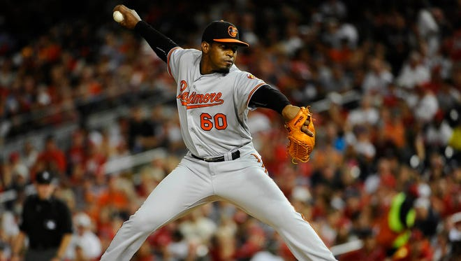 Baltimore Orioles relief pitcher Mychal Givens (60) throws to the Washington Nationals during the sixth inning at Nationals Park.