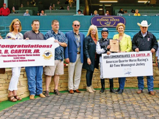 Courtesy   Jockey G. R. Carter, Jr. receives an award for being American Quarter Horse Racing's All-Time Winningest Jockey. The record was set at Ruidoso Downs.