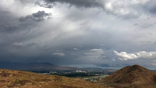 Storms are shown moving toward Reno as seen from Huffaker Hills on Wednesday, May 16, 2018.