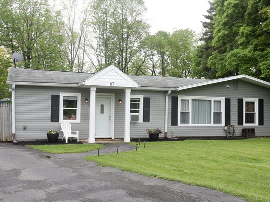 This 1,500-square-foot home in Henrietta is on the market for $130,000, which is the median price for houses in Monroe County.