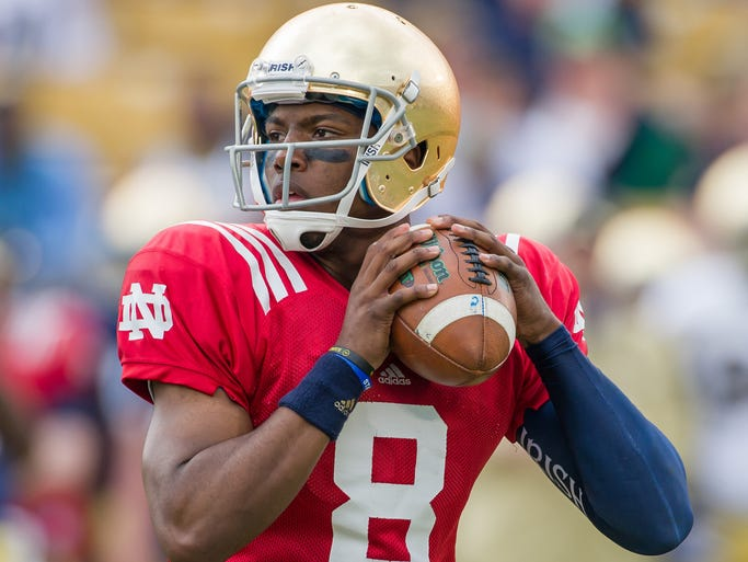 Notre Dame Fighting Irish quarterback Malik Zaire (8) looks to pass in the second quarter of the Blue-Gold game at Notre Dame Stadium.