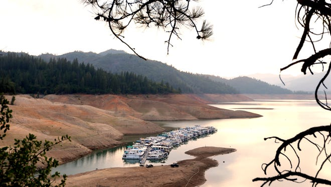House boats are docked  in the low water at Lake Shasta's Bay Bridge resort near Redding on Sept. 17, 2014.