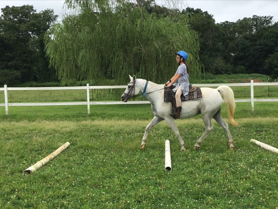 Olivia Marynowicz and Attar ride over the poles during