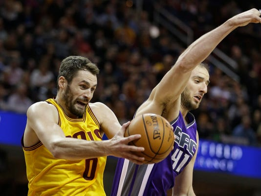Cleveland Cavaliers' Kevin Love (0) grabs a rebound ahead of Sacramento Kings' Kosta Koufos (41) during the first half of an NBA basketball game, Wednesday, Jan. 25, 2017, in Cleveland. (AP Photo/Tony Dejak)