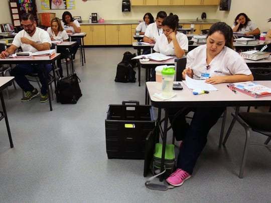 Vocational nursing students review dosage calculations during class at Santa Barbara Business College's location in Rancho Mirage, Calif. on Thursday, September 25, 2014. The class is included in a specialized 14-month program that awards diplomas in vocational nursing.