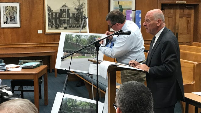 Professional engineer Robert Wells marks a diagram during a hearing before the Millburn Zoning Board as Frank V. Tedesco, right, an attorney representing New Jersey American Water looks ahead on Monday, Sept. 2, 2017.