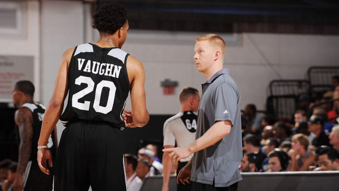 Sean Sweeney, right, speaks to Rashad Vaughn during an NBA Summer League game. Sweeney, 32, is entering his third full season as an assistant coach under Jason Kidd.