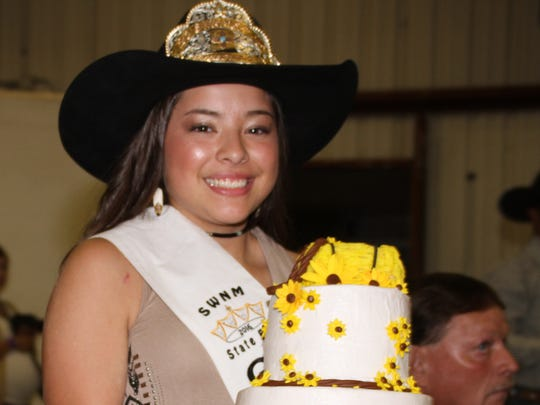 Outgoing 2016 Fair Queen Hanna Mesa helped with Thursday's cake auction during the Southwestern New Mexico State Fair Royalty Pageant. The cake raised $725 and was purchased by Mimbres Valley Feed.
