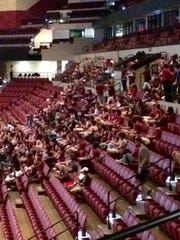 Fans displaced by Hurricane Hermine file into their