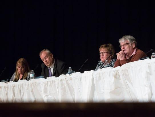 Muncie school board members Debbie Feick and Andy Warrner,