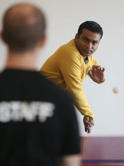 Manish Dixit of Dice.com plays ping-pong
