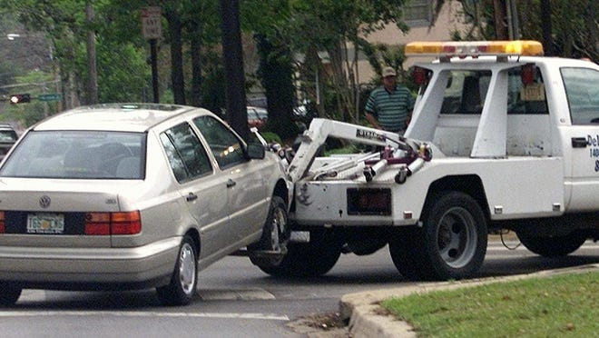 A car is towed away from an FSU parking lot.
