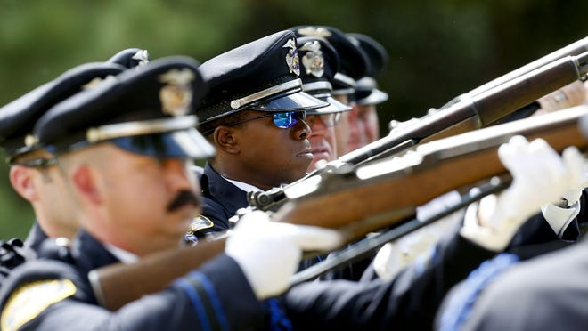 In this file photo from September 2019, an honor guard prepares a 21-gun salute for Tuscaloosa Police Investigator Dornell Cousette, who was buried at New Salem Missionary Baptist Church Cemetery near Aliceville after being killed in the line of duty. To further honor Cousette, the Tuscaloosa City Council is nearing the end of a process to rename 35th Street in his honor