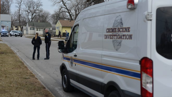 Police investigate a shooting Tuesday at East 15th Street and Garfield Avenue in Des Moines.