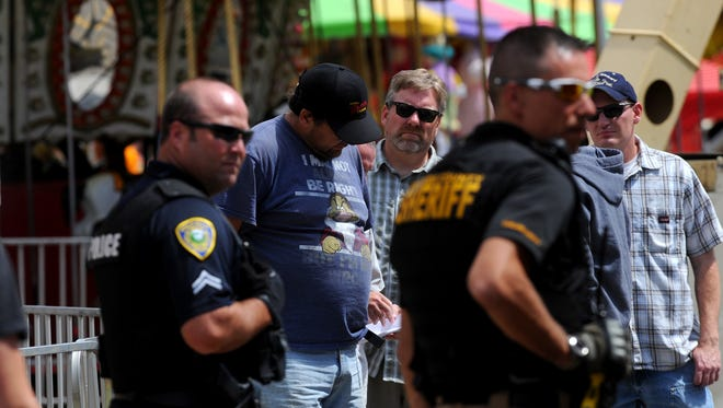 Frederick Karl is placed into custody at 1:45pm on Monday afternoon at the midway of the Montana State Fair.