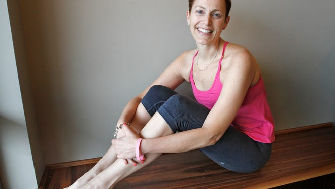 Michele Cohen was diagnosed in January of last year with triple negative breast cancer. After more than eight months of treatment, the 42-year-old Carmel mother of two is returning to her previous life as a fitness instructor and trying to rebuild her strength. She does an hour and a half hot yoga class every Friday morning.