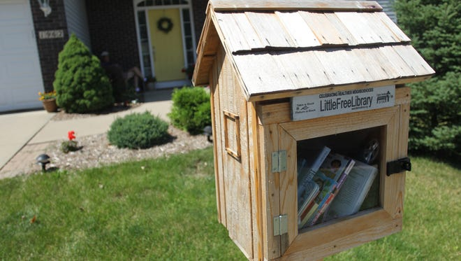 Little Library along Brown Deer Trail on Wednesday, July 10, 2013.