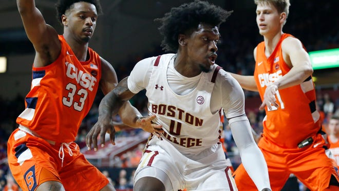 Syracuse's Elijah Hughes (33) and Marek Dolezaj (21) defend against Boston College's CJ Felder (0) during their game last year. Felder has transferred to Florida.