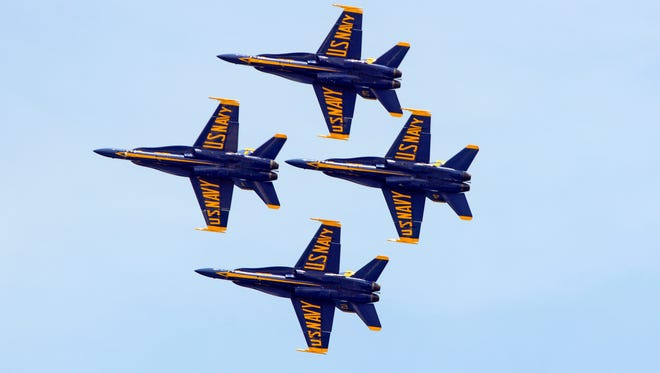 The Blue Angels perform for the crowd during the Blue Angels Air Show Saturday, July 8, 2017 at Pensacola Beach.