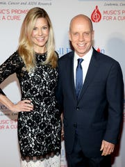 Tracie and Scott Hamilton attend  the T.J. Martell