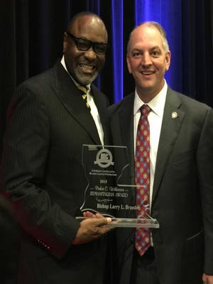 Bishop L. Lawrence Brandon with Governor-elect John Bel Edwards.