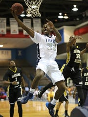 JSU forward Treshawn Bolden (22) will be playing his ninth year under his former high school and current college coach Wayne Brent.
