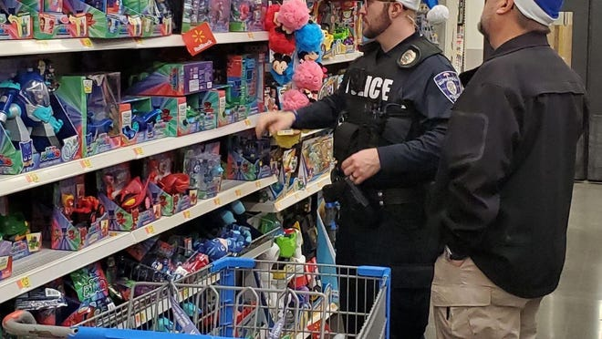Members of the McPherson Police Department will be shopping for children's gifts on Dec. 16 as part of the Blue Santa Program.