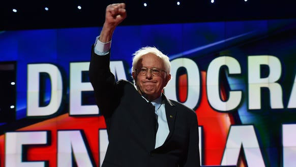 Bernie Sanders waves as he arrives on stage for the