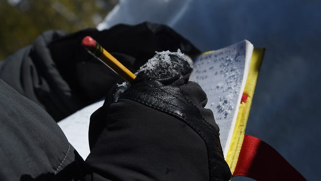 Owner of the Tahoe Mountain School and official observer for the Sierra Avalanche Center Steve Reynaud records information he gathered from digging a snow pit on a northeast slope on Mount Tamarack near the top of Mt. Rose Highway south of Reno on Feb. 24, 2015.
