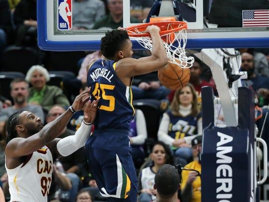 Utah Jazz guard Donovan Mitchell (45) dunks the ball