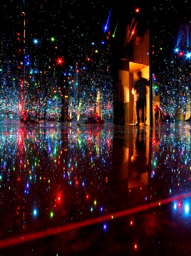 "Yayoi Kusama's ""You Who Are Getting Obliterated in the Dancing Swarm of Fireflies"", is enjoyed by art lovers at the Phoenix Art Museum on January 18, 2014."