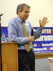 U.S. Sen. Sherrod Brown speaks and introduces Ron Abrams during a rally Friday evening at the Richland County Democratic Party headquarters.