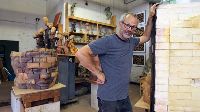 From the cover: James Tyler, the Executive Director at the Garner Arts Center in Garnerville, is pictured with some of his sculptures. The center will be holding its Arts Festival on May 30 and May 31. Studios will be open, there will be live music, refreshments and other activities.