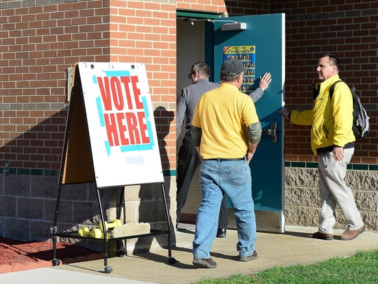 Voters at Selbyville Middle School cast their ballot