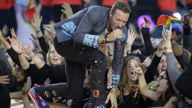 Singer Chris Martin of Coldplay performs during halftime of the NFL Super Bowl 50 football game on Feb. 7, 2016, in Santa Clara, Calif.