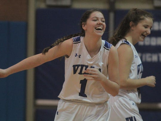 Villa Madonna senior Madison Perry, 1, celebrates after