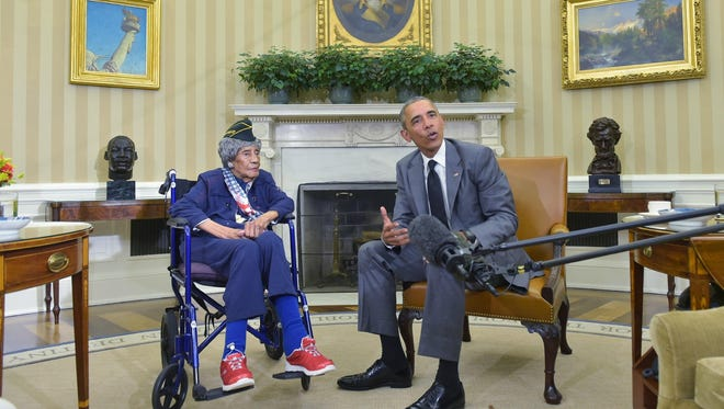 President Barack Obama meets with the country's oldest living veteran, 110-year-old Emma Didlake, in the Oval Office of the White House on Friday.