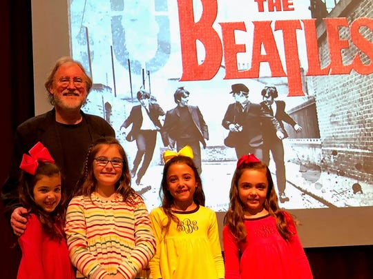 "Beatles Lecture - For the Third Annual Shoulders Family Lecture Series, the renowned IU School of Music Provost Professor Glenn Gass enlightened the well-attended crowd with his informative and lively lecture on ""The Beatles: Rock & Roll Becomes High Art.""  Gathered in the Harrison High School auditorium on stage with Dr. Gass are cousins, from left, Quinn Bucur, Emma Shoulders, Belle Bucur and Addie Bucur."