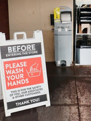 A sign asking patrons to wash their hands before entering the store sits outside of Dierbergs in Osage Beach.