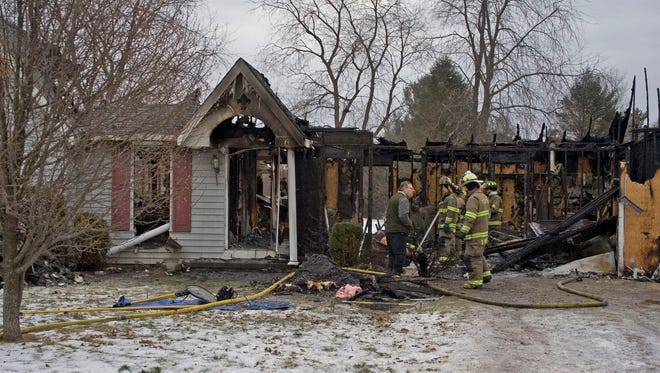 Fire investigators work to determine the cause of a fatal fire early Tuesday that destroyed a home at 116 Valley Lane in Horseheads.