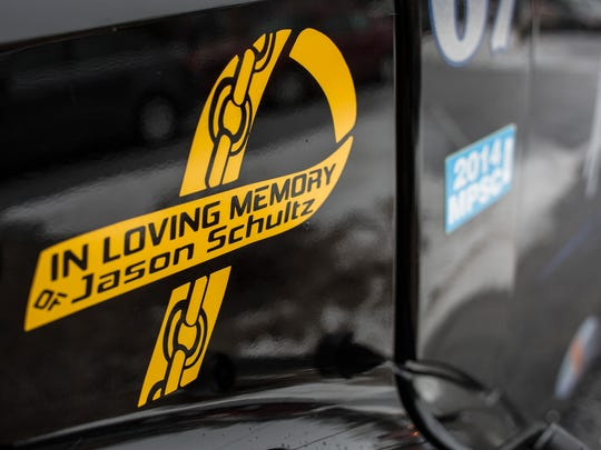 Preferred Towing vehicles donned ribbons during a funeral