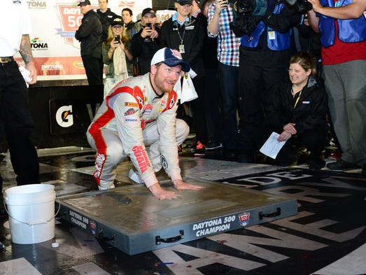 NASCAR Sprint Cup driver Dale Earnhardt Jr. (88) inshrines his hands in cement after winning the Daytona 500 at Daytona International Speedway.