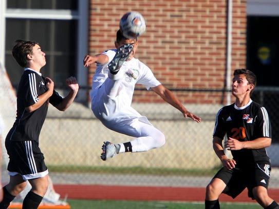 Long Branch's Stiviny Silva (center) kicks the ball