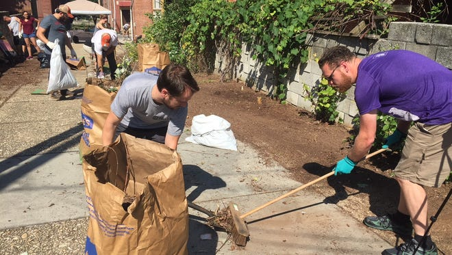 Volunteers with York XL clean up a walkway in York June 30.