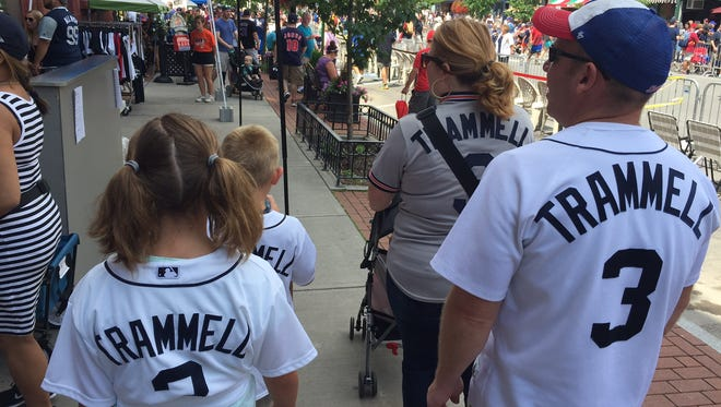 A family with Alan Trammell jerseys walks through Cooperstown on Saturday.