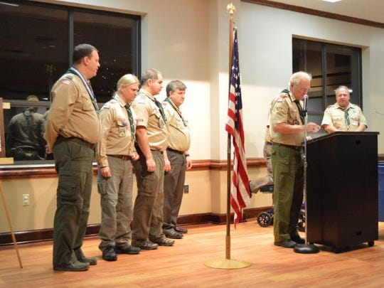Scoutmaster Tim McNeive presents BSA Veteran receipients Mark Jackson, Adrian Wiggins, Ryan Verk, Charles Lloyd, Bishop Norris and John Raffety.