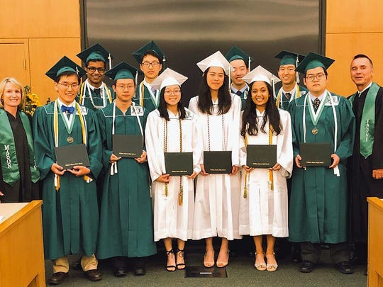 Several Mason High School graduates on the Science Olympiad team missed their graduation because they were competing at the national competition -- a first in the school's history. Those seniors are, from left: back, Suhas Kolli, Alex Wang, Jeffrey Huang and Terry Luo. Front: Superintendent Gail Kist Line, Timothy Huang, Jack Li, Alyson Lam, Jenny Wan, Rangani  Ramasubramanian, Wei Gao and Principal Dave Hyatt.
