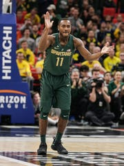 Michigan State's Tum Tum Nairn Jr. cheers for teammates