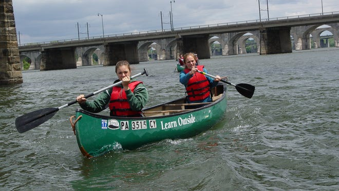 Fairfield students Rebekah Finafrock (front) and Abby Hebenton (back) compete in the Chesapeake Bay Foundation's Canoe Classic on May 15.
