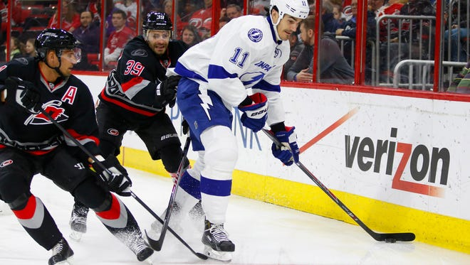 Tampa Bay Lightning forward Brian Boyle (11) skates with puck against Carolina Hurricanes forward Patrick Dwyer (39) during the first period at PNC Arena.